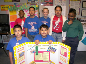 Students presenting at a science fair
