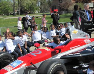 Photo of students with race car